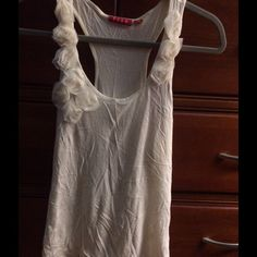 Sweet Racerback tank with rosette detailing. Off white Racerback tank.  Rosette detail at scoop neck.  Lightweight and soft.  60% Pima cotton/40% modal.  So sweet! Elle Tops Tank Tops