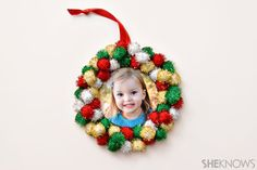 Pom-pom wreath ornament is simple enough for kids to make and their photo in the middle makes it a sweet keepsake (@ She Knows)