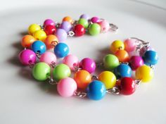 Custom hand-linked rainbow beaded layered beaded bracelet by Katya Valera ~ jewelry you love. Handmade, exclusive jewelry for sale on Etsy. Find out more at https://www.facebook.com/KatyaValeraJewelry
