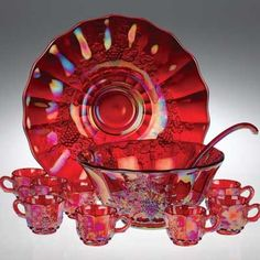 *RUBYWARE PUNCH BOWL SET ~ Carnival Glass, cast from a century-old collection, this dazzling opalescent glass marries all of the colors in existence within crimson. 8 cups, plate, bowl and ladle. Antique Dishes, Antique Glassware, Vintage Dishes, Vintage Pyrex, Vintage Dinnerware, Vintage Kitchenware, Vintage Items, Punch Bowl Set, Crystals