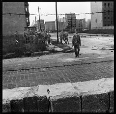 View of East German soldiers on the other side of the Berlin wall at the time of the its construction, West Berlin, Germany, August 1961