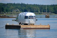 This is just the coolest find!! Floating #Airstream campers... best of both worlds don't you think? #camping #RVing