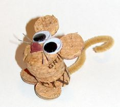 """An animal lover, I thoroughly enjoy creating fun creatures using recycled corks - whether as three-dimensional figurines or as wall hangings. In fact, the first ever """"Cork Creation"""" was a dog. Wine Craft, Wine Cork Crafts, Wine Bottle Crafts, Diy Cork, Wine Cork Ornaments, Snowman Ornaments, Wine Cork Projects, Wine Cork Art, Wine Bottle Corks"""