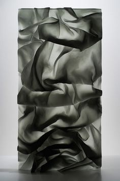 karen lamonte cast glass drapery. This glass seems as if it has fabric incorporated within it therefore it seems as if it has a 3D effect. This glass allows a semi private view for the person. This type of glass may be able to work in a range of interiors.