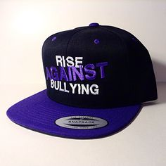 This hat is a purple and black snapback!  Available now at www.blankhatsforcharity.com