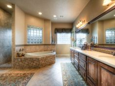 Lightly decorated master bath with plenty of open space and hidden, walk-in shower behind the bathtub. Dream Bathrooms, Rustic Bathrooms, Beautiful Bathrooms, Shower Installation, New Home Builders, Custom Builders, Dream House Plans, Dream Houses, Dream House Interior