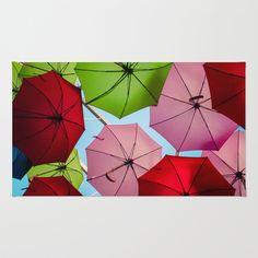 Colorful umbrellas. Rug by Sarah Brust - $28.00