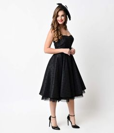Flock and flaunt! A beguiling black swing fresh from Hell Bunny, the Tsapella dress is elegantly structured in a gorgeous 1950s prom dress reminiscent silhouette with marvelous modern touches. A velvet dot flocked woven fabric rests over generous layers o