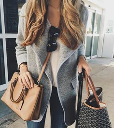 Ashley Robertson pairs a grey overcoat with a gorgeous brown leather bag and a pair of simple shades.  Brands not specified.