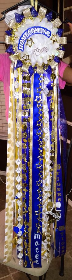 Blue, white, and gold homecoming mum!