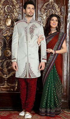 Wear this off white brocade men's sherwani to give you traditional look. The brilliant attire creates a dramatic canvas with moti, patch, resham, stones and velvet patch work. Brocade might vary from actual image. #Men'sSherwani