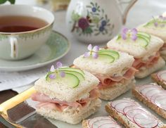 These Ham, Pineapple, and Cucumber Sandwiches, garnished with thin slices of cucumber and edible flowers, will add a touch of elegance to your tea table.