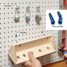 Go Hookless - You can craft your own hooks using stuff from the hardware aisle. Clip the tips from No. 6 hollow wall anchors, drive them into 1/4-in. pegboard holes, then secure your custom tool holder by driving screws into the anchors. Short 5/16-in.-diameter lag bolts fit snugly into 1/4-in. holes to create inexpensive hangers for lightweight objects.