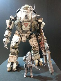 """Titanfall: Atlas painted prototype on display at Thailand Toy Expo next to unpainted (will come fully painted tho) 6"""" tall pilot. #threezero #Titanfall #ThailandToyExpo #gaming #videogame #collectible #toyphotography #actionfigure #toyplanet #comingsoon #WIP #Titan"""
