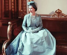 Norman Hartnell, Evening dress of turquoise ribbed silk and lace w bolero and belt. Worn by The Queen for the Marriage of Princess Margaret at Westminster Abbey, 6 May 1960. The Royal Collection, RCIN 100041 (dress); 100042 (jacket) © 2008, Her Majesty Queen Elizabeth II