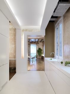 indirect lighting, streamlined counter top and sink...with a visual...nice!
