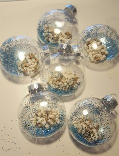 working on a coastal christmas tree shells glitter