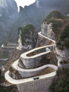 Winding Roads on Tianmen Mountain  Sure glad someone else went there and took this picture, because there is NO WAY IN HECK I would survive this trip.