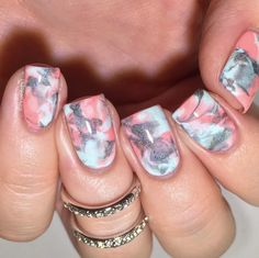 Using pink and gray NCLA Bikinis & Martinis, Take A Dip and From LA to Anywhere polishes, the manicurist gave these nails a cool marbled effect. She dropped blobs of polish onto the nails, then used a Ziploc bag to squish the droplets into the marble design.  Image: @mrswhite8907