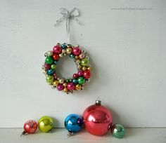 Wreath ornament made from vintage beads from Into Vintage: Wrapping up a little vintage Christmas