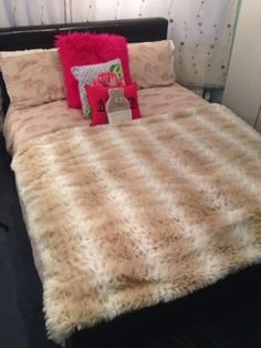 Love my fur throw over my bed in winter. Makes my room feel so much warmer!!