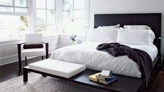 All-white bedroom with African wenge wood floors