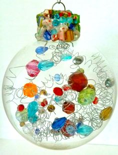 I like this idea- clear glass ball with beads and wire spirals inside.