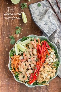 GORGEOUS! Applebee's copy-cat salad with an Asian salad blend, sliced almonds (or peanuts), peanut sauce shrimp, wonton strips, fresh cilantro, red bell pepper strips, and a chili lime vinaigrette via Chelsea's Messy Apron