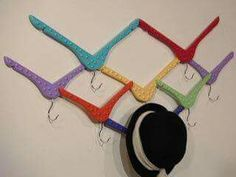 Wood hangers repurposed as a hat rack