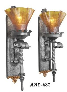 Pair of Gothic or Medieval Iron sconces with Crackle Glass Shades (ANT-437) #vintage #reproduction #recreation #antique #art #deco #nouveau #doorknob #hardware #lighting #unique #switchplate #victorian #hinge #brass #cast #metal #eastlake #windsor #shade #crystal #glass #electrical #cover #gang #plate #pendant #arts #crafts #mission #period #decor #rail #railing #rococo #romantic #beaux #newel #post #knight #induction #grow #heat #lamp #church #gothic #goth