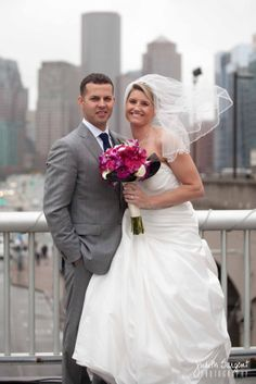 Cityscape wedding portrait  Captured by Judith Sargent Photography Inc.