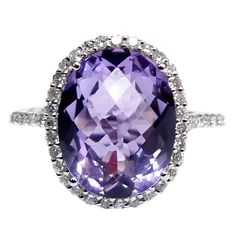 This beautiful ring features a 6.28ct Fine quality purple amethyst in the center, surrounded by 0.50 carats of round brilliant diamonds at 1stdibs.