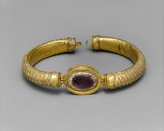 Gold and glass bracelet with central medallion Period: Hellenistic Date: 2nd century B.C. Culture: Greek Medium: Gold and glass