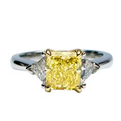 Fancy Radiant Ring with Trillions   From a unique collection of vintage three-stone rings at http://www.1stdibs.com/jewelry/rings/three-stone-rings/