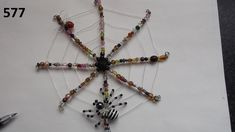No.577 - my first attempt at a Spiders Web - with a small Spider & smaller Fly caught in the Web - my Web BeadBug - Wire and Bead BeadBugs - Jill Norman