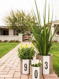 HGTV shows how to take your house numbers to the next level with these modern, DIY planters that pack major curb appeal. Diy Projects Cans, Outdoor Projects, Diy Planters, Modern Planters, Spring Home, Spring Style, Spring Garden, House Numbers, Front Yard Landscaping