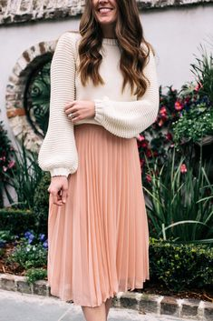 Liz Adams shares the details on this perfect pink pleated skirt (under $50) and her goals for finding happiness in the new year.
