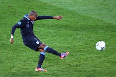 Ashley Young gets a shot away against Sweden