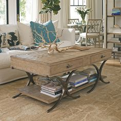 Windward Dune Coffee Table. Love the driftwood color of the wood with the iron, and look at all that storage!