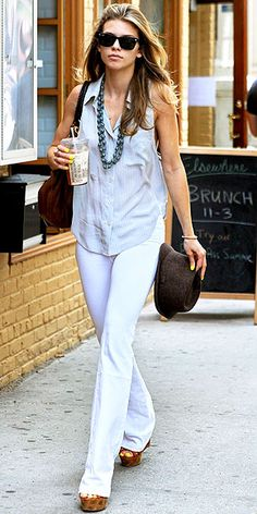 high-waisted white trousers, a sleeveless button-up and wedges