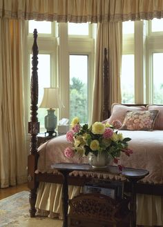Traditional bedroom. Carved mahogany four poster bed.