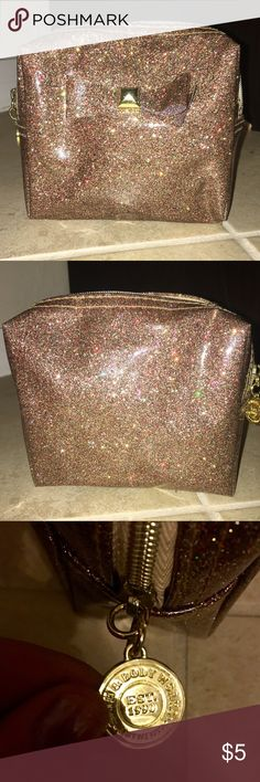 Bath & Body Works small sparkle beauty case w/ bow Bath & Bodyworks small pink purple and gold sparkle cosmetics case with bow on front .  Consider it in a bundle ! Great for cosmetics, perfume, traveling, lipsticks, hair supplies etc.  Tags: girls makeup sephora toiletries perfume rose gold Bags Cosmetic Bags & Cases