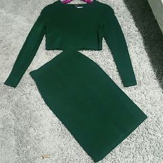 Hunter Green Midi Skirt and Crop Top Set Thick sweater material that clings to the bodies every curve. Size Medium cam easily fit a large nice and snug.  Holiday Ready, warm and Sexy and still classy. BRAND NEW, ONLY SELLING AS SET ANGL Dresses Midi