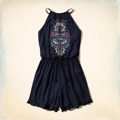 Embroidered Peasant Romper: Lightweight and drapey with a drawstring waist, halter neckline, ruffle hem and embroidered design at front.