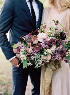 romantic wine bouquet featuring peonies, lilacs, and clematis by Gathering Events