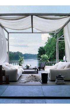 Breezy outdoor summer lounge with white canopy.