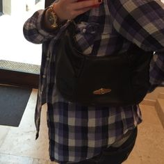 Elliot Lucca Small hobo styled bag. Woven handle is in good shape. It's missing the tassel grip that assisted in zipping up the zipper. The leather is in great shape. While on the smaller side, you can fit all your essentials in here. Elliott Lucca Bags Hobos
