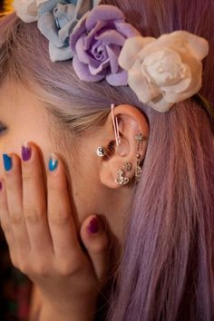 Loads of ear piercings pastel hair