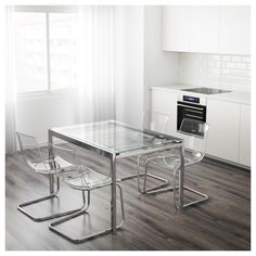 IKEA GLIVARP Extendable table Transparent/chrome-plated cm The glass table top lets light through, which makes the table feel neat and blend in. Table Desk, Table And Chairs, Ikea Table, Extendable Glass Dining Table, Clear Chairs, Table Extensible, Dinner Room, Table Height, Dining Room