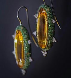 A combination of platinum, gold and bronze with a natural green patina allow these unique Beryl earrings to glow.